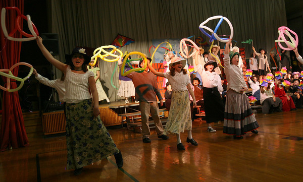 """Gloucester: Plum Cove Elementary School students sing """"Let's Go Fly a Kite"""" during their performance of """"Mary Poppins,"""" which ran Thursday and Friday. Students in grades 3-5 sang, danced, and assisted with the set. Photo by Kate Glass/Gloucester Daily Times<br /> , Gloucester: Plum Cove Elementary School students sing """"Let's Go Fly a Kite"""" during their performance of """"Mary Poppins,"""" which ran Thursday and Friday. Students in grades 3-5 sang, danced, and assisted with the set. Photo by Kate Glass/Gloucester Daily Times"""