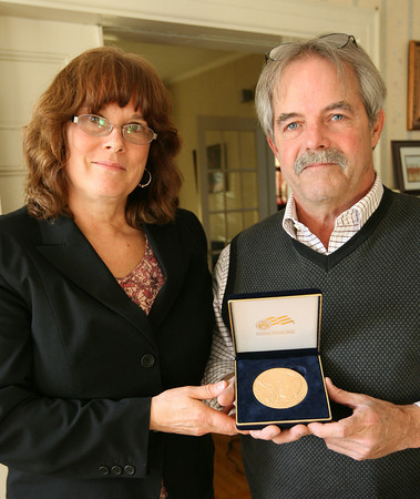 Gloucester: Katherine and Glenn Keefe display the Congressional Gold Medal awarded to Lyda Bunham for her service in World War II as part of the Women Airforce Service Pilots. The Keefes traveled to Washington, D.C. to accept the award in her honor. Photo by Kate Glass/Gloucester Daily Times