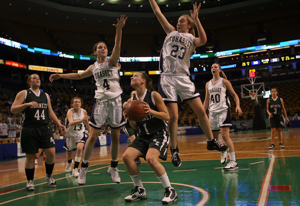 Boston: Cohasset's Carli Haggerty and Samantha Crough try to block Manchester Essex's Lizzy Ball during the MIAA Division 4 State Finals at the TDGarden in Boston yesterday. Photo by Kate Glass/Gloucester Daily Times