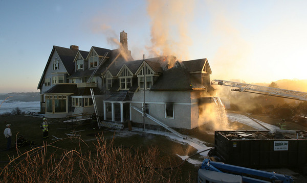 Gloucester: Gloucester and Rockport Firefighters battle a fire on Bass Rocks Road yesterday evening. Photo by Kate Glass/Gloucester Daily Times