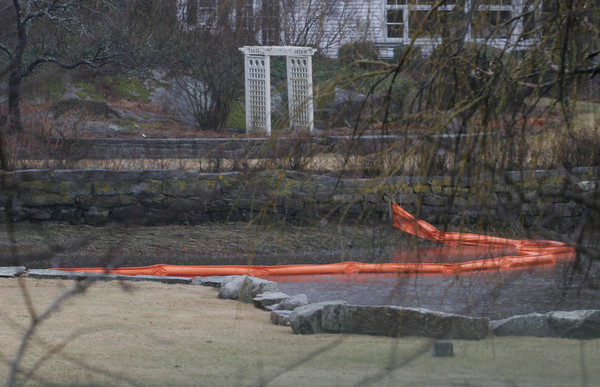 Gloucester: Gloucester Police and the U.S. Coast Guard set up this boom to contain a fuel spill in Lobster Cove yesterday. Photo by Kate Glass/Gloucester Daily Times