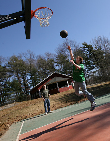 Essex: Ethan Steen leaps for a shot as he plays basketball at Centennial Grove with Mike Loebelenz on Wednesday afternoon. The two say they try to play there when they have half days at school. Photo by Kate Glass/Gloucester Daily Times