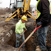 Essex: Rick Hicks, left, and John Soares of J. Marchese and Sons dig down to the water main running along the Causeway as the crew resumes construction after shutting down for the winter. Photo by Kate Glass/Gloucester Daily Times
