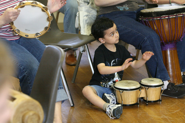 Gloucester: Giuseppe Tra, 5, of Manchester drums to the beat of the drumming circle lead by Otha Day at the First Parish Chapel at an African Drumming program put on by the Manchester Public Library Saturday afternoon. Mary Muckenhoupt/Gloucester Daily Times