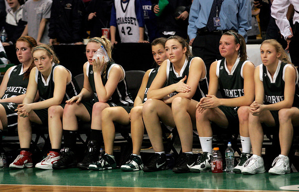 Boston: The Manchester Essex Hornets watch as the Cohasset Skippers begin celebrating their 50-40 win in the MIAA Division 4 State Finals at the TDGarden in Boston yesterday. Photo by Kate Glass/Gloucester Daily Times