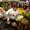 Gloucester: Eric Lorden of Passport's Restaurant cooks up some Cajun shrimp as Elaine Brown, left, assists him at the fifth annual Home and Garden Show put on by the Cape Ann Chamber of Commerce at the Gloucester High School field house Saturday afternoon. Lorden was making what he calls Cajun shrimp and guacamole chips which were quickly eaten by those who came to watch the cooking demonstration. Mary Muckenhoupt/Gloucester Daily Times