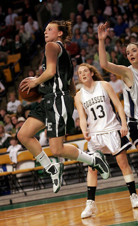 Boston: Manchester Essex's Lizzy Ball flies past Cohasset's Meredith Kelly in the MIAA Division 4 State Finals at the TDGarden in Boston yesterday. Photo by Kate Glass/Gloucester Daily Times