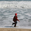 Manchester: Jack Cornforth, 9, gets a little wet as the tide quickly comes up onto Singing Beach Wednesday afternoon.  Jack was at the beach with his family enjoying the warm weather but had little beach to play on due to the high tide and big waves. Mary Muckenhoupt/Gloucester Daily Times