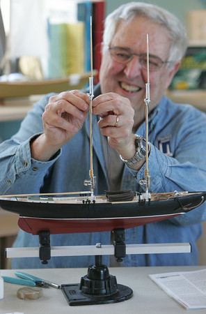 "Gloucester: Tony Ashdon of Rockport ties on the shrouds to the model schooner he is buliding to replicate the We're Here from ""Captains Courageous"" at the Maritime Heritage Center Saturday afternoon.  Mary Muckenhoupt/Gloucester Daily Times"