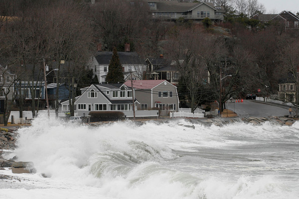 Rockport: The section of Beach Street near Back Beach was closed for several hours yesterday as the combination of a storm surge and high tide brought the waves over portions of the road. Photo by Kate Glass/Gloucester Daily Times