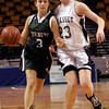 Boston: Manchester Essex's Samantha Christopher dribbles past Cohasset's Samantha Crough in the MIAA Division 4 State Finals at the TDGarden in Boston yesterday. Photo by Kate Glass/Gloucester Daily Times