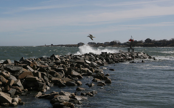 Rockport: Water splashes over the Breakwater at the end of Bearskin Neck yesterday during high tide. Photo by Kate Glass/Gloucester Daily Times