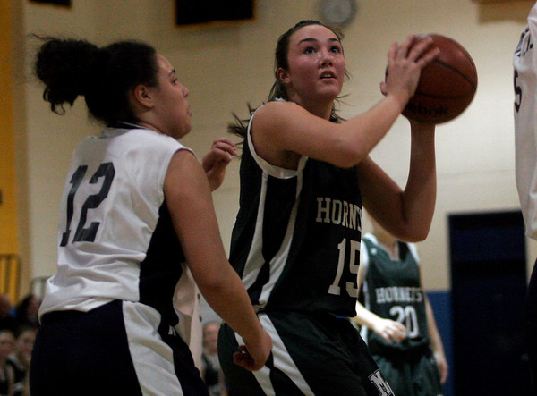 Malden: Manchester Essex's Alicia Volpe shoots over Presentation of Mary Academy's Rosaly Pagan during the MIAA Division 4 North Semi-Finals at Malden High School last night. Photo by Kate Glass/Gloucester Daily Times