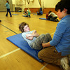 Essex: Patrick McTiernan, 11, keeps track of how many situps Cameron Lane, 11, does in a minute during a fitness test at Essex Elementary School on Monday afternoon. Cameron did 46 situps and Patrick did 42. Photo by Kate Glass/Gloucester Daily Times
