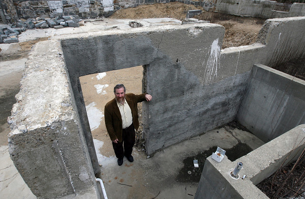 Gloucester: Rabbi Samuel Barth of Temple Ahavat Achim stands in the former entrance to the temple offices, which were destroyed in the Middle Street fire of 2007. The temple will be breaking ground on their new building on April 18th. Photo by Kate Glass/Gloucester Daily Times