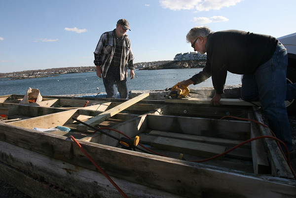 Rockport: Charlie Nichols and Norman Fredette make repairs to their float at Old Granite Pier on Monday. They built the float 15 years ago and were getting it ready for April 14th, when floats can go in the water. Photo by Kate Glass/Gloucester Daily Times