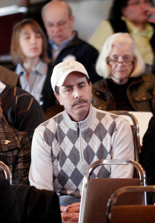 Larry Ciulla, owner of the Gloucester Seafood Display Auction, listens to testimony at a hearing of the U.S. House Oversight and Government Reform Domestic Policy Subcommitee yesterday focusing on fisheries enforcement practices at Gloucester City Hall. Photo by Kate Glass/Gloucester Daily Times