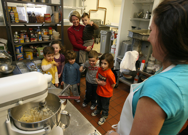 Gloucester: Tami Cronin and her Pre-K students at Eastern Point Day School dance as Nicole Duckworth mixes chocolate chip cookie dough at Duckworth Beach Gourmet on Monday. The kids, (from left) Ben Duckworth, Maggie Sperry, Jack Moran, Nikolas Karvelas, Sebastian Lovasco, and Anita Magee, were baking the cookies to include in a basket for 7 soldiers from Gloucester that are serving in Iraq and Afghanistan. Also going in the basket will be candy, socks, playing cards, Dunkin Donuts coffee, games, and T-shirts from Seaside Graphics. Photo by Kate Glass/Gloucester Daily Times