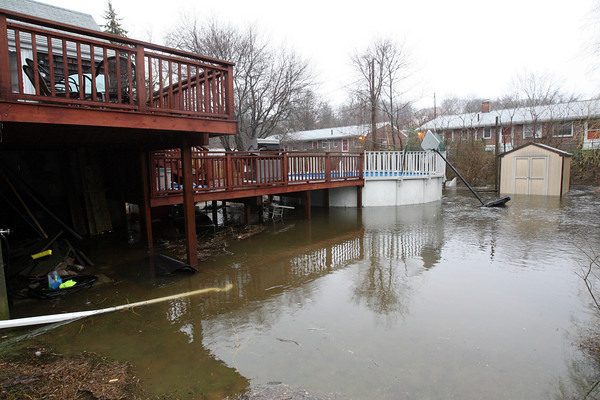 Gloucester: The Alewife Brook now flows through the backyards of homes along Poplar Street. Photo by Kate Glass/Gloucester Daily Times