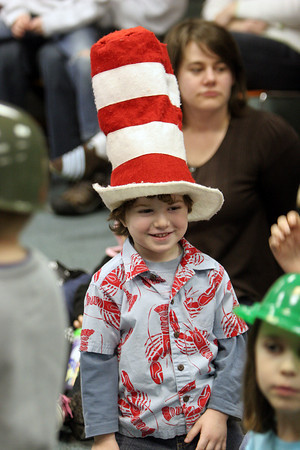 Gloucester: Sam Pallazolla, 3, wears a special Cat in the Hat hat at the Cat in the Hat birthday party at the Sawyer Free Library Saturday afternoon. Mary Muckenhoupt/Gloucester Daily Times