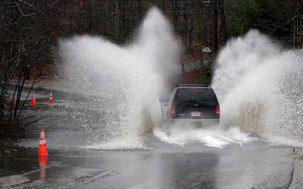 Gloucester: An SUV flies through a flooded section of Hesperus Avenue yesterday afternoon as rain returns to the area. Photo by Kate Glass/Gloucester Daily Times