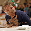 Gloucester: Tyler Lucas, a 7th grade student at O'Maley Middle School, checks out the competition in the March Madness pie-eating contest on Wednesday. Lucas won his round of the contest. Photo by Kate Glass/Gloucester Daily Times