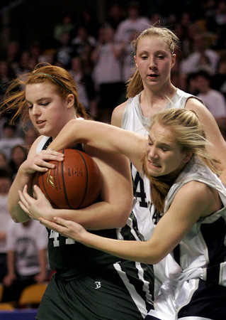 Boston: Manchester Essex's Leanne Ciccone grabs the ball from Cohasset's Anna Seraikas during the MIAA Division 4 State Finals at the TDGarden in Boston yesterday. Photo by Kate Glass/Gloucester Daily Times