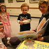 "Rockport: Adelaine Akers, Elowyn Akers, and Aiden Cahill listen as Kate Cahill reads ""The Queen of Easter"" by Mary Engelbreit during story hour at the Rockport Library on Tuesday. The library hosts story hour every Tuesday at 10 am. Photo by Kate Glass/Gloucester Daily Times"