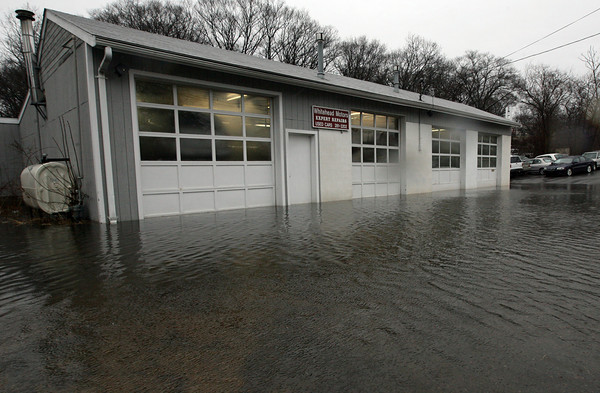 Gloucester: Water pooled up around Whitehead Motors and two neighboring houses at the corner of Cherry and Poplar Streets. Photo by Kate Glass/Gloucester Daily Times