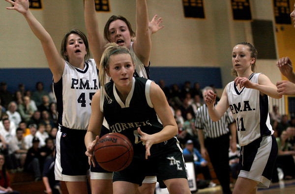 Malden: Manchester Essex's Julia Martz dodges Presentation of Mary Academy's defense during the MIAA Division 4 North Semi-Finals at Malden High School last night. Photo by Kate Glass/Gloucester Daily Times