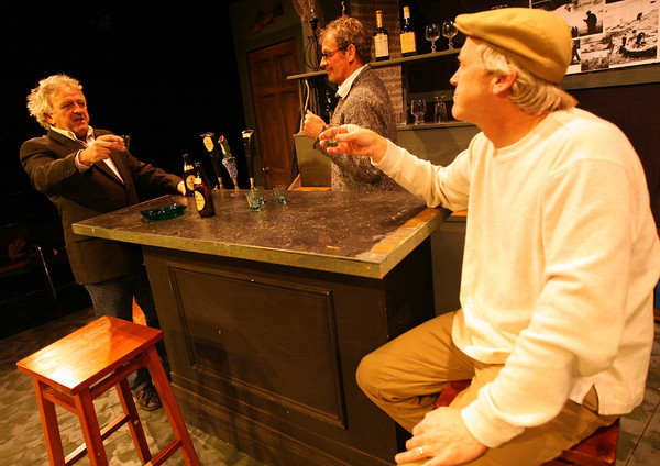"""Gloucester: Michael McNamara, Rory O'Conner, and David McCaleb raise a glass as they rehearse a scene from """"The Weir"""" by Conor McPherson. The play, produced by the Cape Ann Theatre Collaborative, will be at Gloucester Stage March 19-21, and March 26-28. Photo by Kate Glass/Gloucester Daily Times"""
