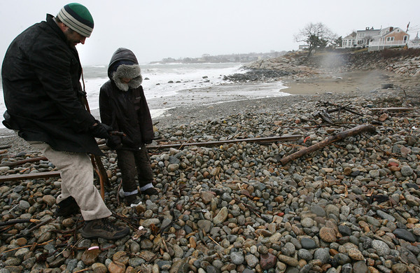 Rockport: Mark Kanegis and his daughter, Elise, search for driftwood on Back Beach yesterday afternoon. Mark says he hangs the wood in his gallery on Bearskin Neck and some at his home. Photo by Kate Glass/Gloucester Daily Times