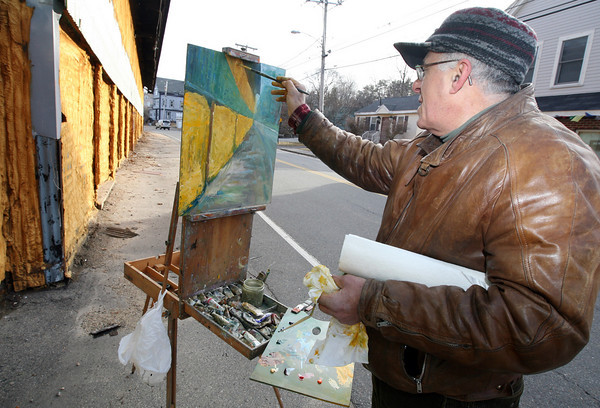 """Rockport: Peter Herbert of Annisquam works on a painting of the Cape Ann Tool Company Tuesday afternoon. """"I've been driving by this for 30 years and have always wanted to paint it,"""" he says. Photo by Kate Glass/Gloucester Daily Times"""