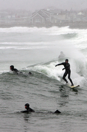 Gloucester: Surfers take advantage of 6-foot waves at Cape Hedge Beach in Rockport Thursday afternoon. Mary Muckenhoupt/Gloucester Daily Times
