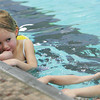 Gloucester: Kailae Rochford, 4, watches the kids in her class swim to the edge of the pool during swim class at the YMCA Thursday afternoon.  Kailae was a little nervous to get her face wet but enjoyed taking class with her brother Trey, 7, this being their first day of swim lessons. Also pictured Joshua Greek, 5, right, Mary Muckenhoupt/Gloucester Daily Times