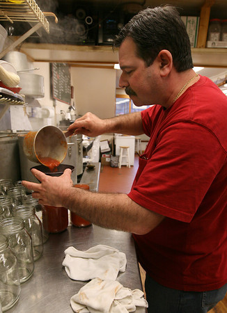 Gloucester: Joe Virgilio bottles their Tomato & Basil Pasta Sauce, which they sell at their store on Main Street and at Market Basket. Photo by Kate Glass/Gloucester Daily Times