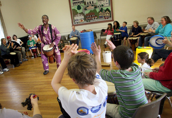 Manchetser: Otha Day leads a drumming circle with kids and adults at the First Parish Chapelin Manchester Saturday afternoon. Day teaches how African Drumming helps mind, body and spirit balance and promotes a helathy lifestyle and stress reduction.  The event was sponsored by the Hooper Fund grant to the Children's Room and the Manchester Public Library. Mary Muckenhoupt/Gloucester Daily Times