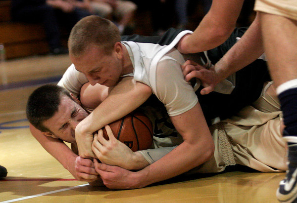 Malden: Manchester Essex's Joe Mussachia wrestles Winthrop's Jake Connors for the ball during the MIAA Division 4 North Semi-Final at Malden High School last night. Photo by Kate Glass/Gloucester Daily Times