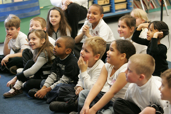 """Gloucester: Students in Marla Polizzia's kindergarten class listen to Gordon Baird read """"All the World"""" as part of First R Reading program Friday morning at Beeman Elementary School. Mary Muckenhoupt/Gloucester Daily Times"""