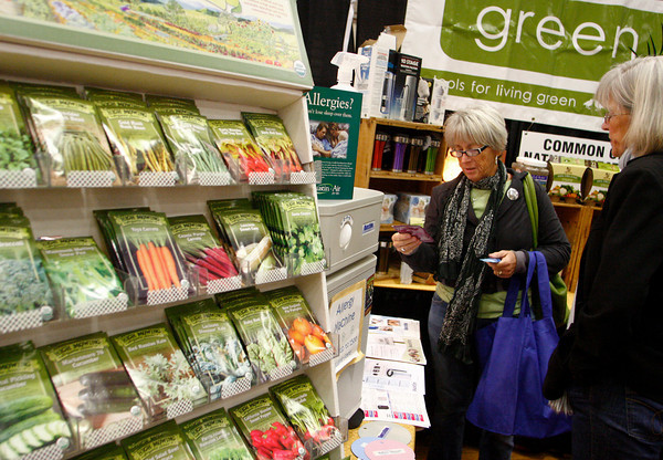 Gloucester: Brenda Davis of Gloucester looks over some things with the help of Gail Roy, right, at the Green Life booth at the fifth annual Home and Garden Show put on by the Cape Ann Chamber of Commerce Saturday afternoon. Mary Muckenhoupt/Gloucester Daily Times