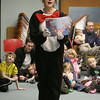 Gloucester: Carole Finn-Weidman, dressed as the Cat in the Hat reads Dr. Suess books at the Cat in the Hat Party at the Sawyer Free Library Saturday afternoon. Mary Muckenhoupt/Gloucester Daily Times
