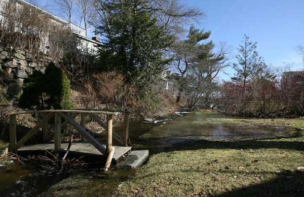 Rockport: Water from Mill Pond flowed into Millbrook Meadow, but was largely contained by the dam. Photo by Kate Glass/Gloucester Daily Times
