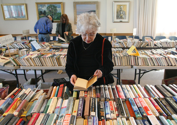 Rockport:  Alice Whittaker looks over all the books for sale at the Friends of the Rockport Library's Cabin Fever Book and Bake Sale in the Peggy Brenner room of the Rockport Library Friday afternoon.  The book sale is on today from 10 a.m. to 5 p.m. and tomorrow 1 p.m. to 5 p.m.. Mary Muckenhoupt/Gloucester Daily Times