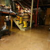 Manchester: Al Centner drove to Concord, N.H. for a pump to clear water from his home on School Street. His driveway was covered in six inches of water and he had a large pool of water on the other side of the house. Despite the water, the home did not sustain any major damage. Photo by Kate Glass/Gloucester Daily Times
