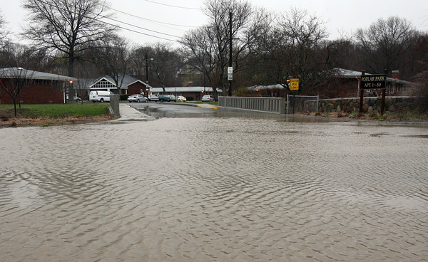 Gloucester: The entrance to Poplar Park was covered in several inches of water. Photo by Kate Glass/Gloucester Daily Times