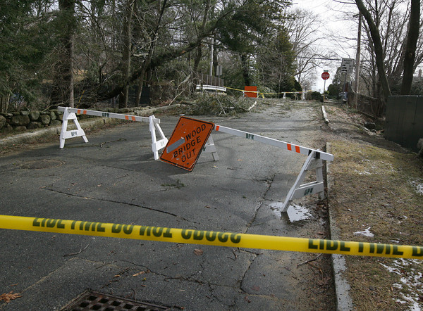 Manchester: Harbor Street was still closed yesterday afternoon as debris from Thursday's storm remained in the road. Photo by Kate Glass/Gloucester Daily Times