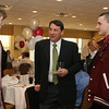 Gloucester: Former Bruins player Mike Milbury talks with juniors Cam Smith, left and Derick MacDowell about their hockey season at the Rockport High School hockey banquet held at the Gloucester House Wednesday night. Mary Muckenhoupt/Gloucester Daily Times