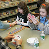 Manchester: Caileigh Cunningham, 10, is unhappy with the cards she was dealt while learning cribbage with her friend Faith Palermo, 9, from George and Renee Moniz at the Manchester Public Library Thursday afternoon. Mary Muckenhoupt/Gloucester Daily Times