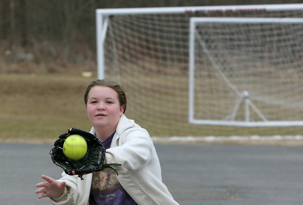 Essex: Amanda Loebelenz, 12, of Essex plays catch with her friend Sarah Reed, 11, Saturday morning behind Essex Elementary School as the girls get ready for softball evaluations held later that day. Mary Muckenhoupt/Gloucester Daily Times