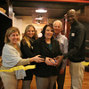 Gloucester: State Rep. Ann-Margaret Ferrante, center, along with Building Center's Susan McAuliff, left, Mari Benham, John Willette and George Whitehead, right, perform the ribbon cutting for the grand opening of the new kitchen and design center at the Building Center in Gloucester Friday afternoon. Mary Muckenhoupt/Gloucester Daily Times